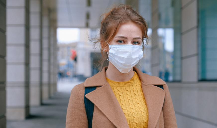 Woman wearing mask - corona virus - Emergency Locksmith 020 38087740